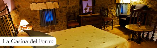 Imagen que muestra la habitación de la Casina del fornu y es un enlace a su página